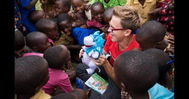 The Christmasaurus and I visit Rwanda with Save the Children. 4