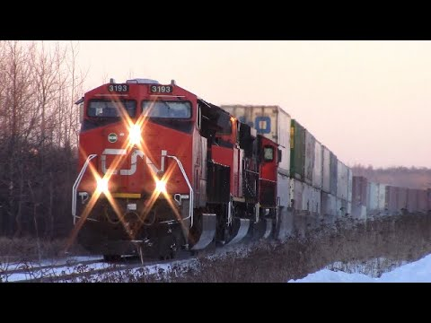 Freezing Cold! Brand New DPU at CN Stack Train 120 thru Memramcook, NB at Track Speed 7